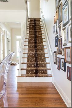 Chic foyer with stairway carpeted in an Antelope patterned stair runner.