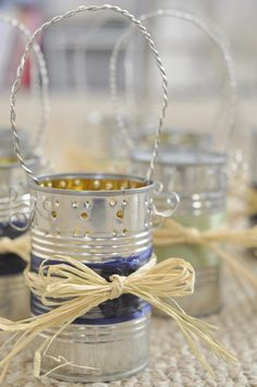 Tin Can table lights from Pinstrosity. Let a candle heat that thing up and the blue ribbon melts all over the table - not to mention the raffia ready to catch fire....Yes, I am a pessimist, my mother made church bazaar crafts...