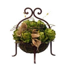 "Faux artichoke arrangement in a scrolling basket.     Product: Faux floral arrangement Construction Material: Silk and plastic Color: Green Features: Will enhance any decor  Dimensions: 18"" H x 17"" Diameter"
