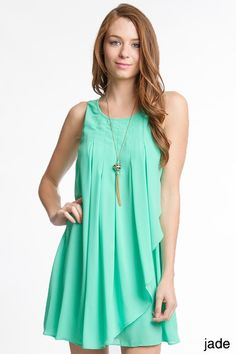 Sleeveless Jade shift dress with front pleated ruffles. Perfect for some fun out in the sun! Fabric Cotton/Polyester