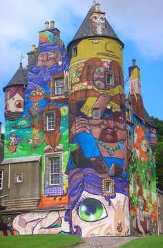 Street art on Kelburn Castle, Scotland. Kelburn brought together four of the world's leading graffiti artists from Brazil to work alongside Scottish talent, to create a unique burst of colour, embracing the walls and turrets of the south side of Kelburn Castle.