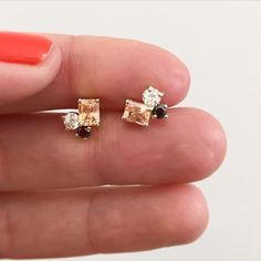 """""""One of a kind peach step cut sapphires, old European cut white diamonds and black diamond stone cluster studs set in 14K YG. Available at the Williamsburg…"""""""