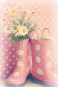 rain galoshes with flowers in them...