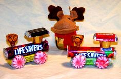 candy train What You Need: 1 roll of Life Savers 1 small package of gum 4 round peppermint candies 1 Hersheys Kiss 1 Rolo candy 1 mini chocolate bar Hot glue gun Ribbons, yarn, string, etc. for hanging (optional)