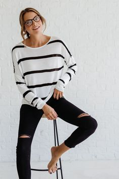 Bella Ella Boutique's Goodnight Moon White Striped Top is a classic look, perfect for the cooler weather. This soft and comfortable top is white with thin black stripes. It has long sleeves and a loose fit. The Goodnight Moon White Striped Top is perfect
