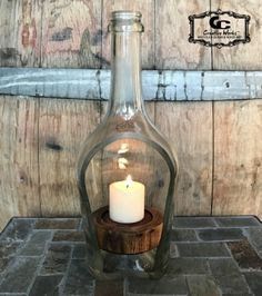 Florence Wine Bottle Candle Holder BELSTAR Prosecco di Valdobbiadene Italy - Sliced cut flame polished finished. Hand-shaped Arizona mesquite live edge wood base circular ridge top cut to level and secure candle. Oil dipped finish. Handcrafted at Hangar 90 Studio, Peoria Arizona