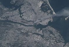Manhattan is also a peninsula; here with a smoke plume on September 11, taken by Expedition 3 crew of the International Space Station.