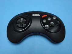 Sega Genesis Remote Arcade Controller :-: Similar in layout and function to the regular wired controller, this gamepad was active with an infrared receiver which was plugged into the console.