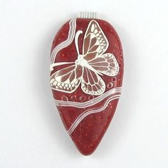Jael of jaelsjewels.etsy.com  is a master of translucent clay.  I love how she uses it in her polymer clay bead designs.  Find out more abou...