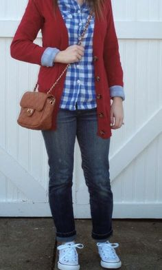 Weekend outfit: Red cardigan, blue gingham shirt, white Converse sneakers.