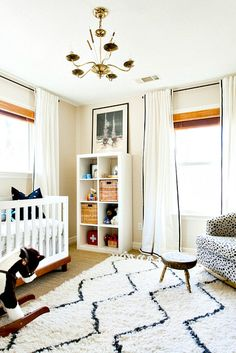 nursery love - gender neutral, and I like how they hung the curtains to make the windows look taller
