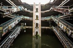 New World abandoned shopping mall with fish in Bangkok - The waterbody which arose after the mall was abandoned became a breeding ground for mosquitos and locals added koi, a large species of colourful carp, and they quickly reproduced, creating the bizarre aquarium filled with fish.