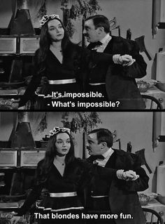 """""""THE ADDAMS FAMILY"""" with Carolyn Jones as """"Morticia Addams"""" and John Austin as her husband, """"Gomez Addams"""";  1964-1966."""