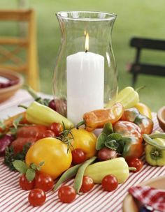 Use veggies and a hurricane lamp for a striking summer centerpiece. More summer decorating ideas:   http://www.midwestliving.com/homes/entertaining/15-fun-easy-centerpieces/page/1/0