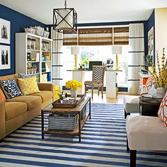 If you're feeling overwhelmed by the range of items you need to store in your home's gathering spots, look to this cohesive and clutter-free living room. Books, magazines, office supplies, and toys are cleverly tucked away without sacrificing style.