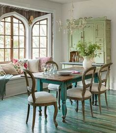 Love this old farm house table. Love the turquoise. And the hutch looks great. It looks warm and cozy.
