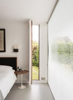 1960s house designed by architects Peter Foggo and David Thomas in the village of Holyport in Berkshire. The property is on the market with The Modern House. Photo from The Modern House.
