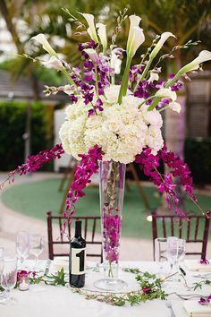Tall Purple and White Arrangement With Hydrangeas Roses and Orchids