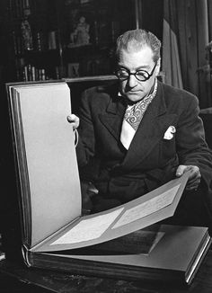 Robert Doisneau   //  Sacha Guitry, the collector, going through an album of autographs, Paris, 1942 .  (  http://www.gettyimages.co.uk/detail/news-photo/sacha-guitry-1944-news-photo/121509418