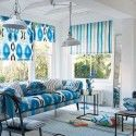 blue window shades and sofa upholstery fabric with ikat pattern and stripes