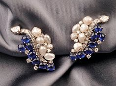 Sapphire, Diamond and Baroque Pearl Earclips, Ruser, each prong-set with cabochon sapphires and freshwater pearls, on a diamond melee stem, 18kt white gold and platinum mounts, lg. 1 1/4 in., signed.