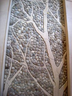 Insert clay structures into pebbles in a mosaic…interesting idea.
