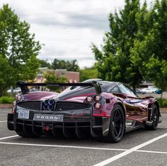"Pagani Huayra BC ""Kingtasma"" in Red and Black carbon fiber w/ Red accents, Tricolore stripes & 24 Karat gold crowns under the rear aerodynamic flaps.     Photo taken by: @zachbrehl on Instagram     Owned by: @sparky18888 & @vtm_theking_4 on Instagram #Pagani"