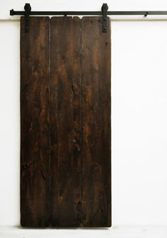 Heavily distressed solid wood planks make this door the epitome of rustic…