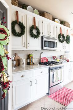 Holiday Kitchen Decor | Decorchick!® Love the wreathes!
