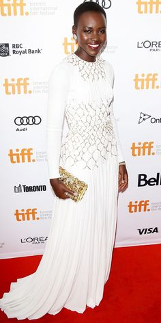 | INSTYLE | Lupita Nyong'o at the '12 Years A Slave' premiere looking magical in a white silk Prada gown and Prada accessories.