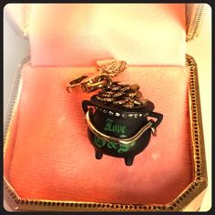 Juicy Couture Limited Edition Pot O' Gold Charm. Juicy Couture Limited Edition Pot O' Gold Charm.  Stamped 2011. Brand New in Tagged Special Gold Box. Mint Condition. Gold Plated Brass. Crown logo. Super adorable little charm! Rare! Juicy Couture Jewelry