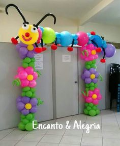 Cute flower balloon arch with caterpillar on top.