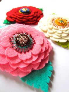 Hair pin, brooch by Ikuko Fujii--such beautiful embroidered flowers.