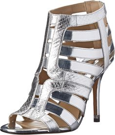 Michael Kors Women's Caleb Silver Palladium Specchio/Metallic Genuine Snake Sandal. Keep it sassy in the Michael Kors Collection™ Caleb. Peep toe ankle boots. Embossed leather upper. Fully strapped from vamp to shaft. Slip on design with back quarter zip closure. Smooth leather lining. Padded leather insole. Wrapped heel. Smooth leather sole. Imported. Measurements: Heel Height: 4 in Weight: 8 oz Shaft: 4 in Product measurements were taken using size 36 (US Women's 6), width M. Please…