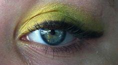Green and yellow eye shadow on blue green eye