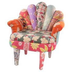 """Multicolor peacock arm chair with a mango wood frame and scalloped back. Made with reclaimed vintage kantha throws.Product: Chair  Construction Material: Mango wood and reclaimed kantha throwColor: MultiFeatures: One of a kindDimensions: 33"""" H x 29"""" W x 20"""" DNote: Due to the vintage nature of this product, some wear and tear is to be expected. Products may show signs of brand marks, scrapes or other blemishes.Cleaning and Care: Spot clean"""