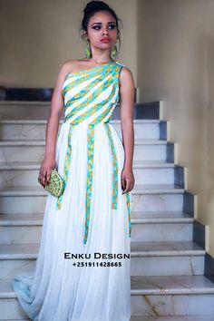 Enkutatash Kibret, better known as Enku, is an upcoming Ethiopian designer and creator of Enku Design.   Based in Addis Ababa, they use combine traditional Ethiopian fabric and prints with modern styles for their innovative African women's wear line.
