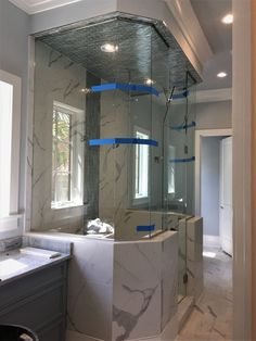 Master Shower With Porcelain Carrara Knee Walls And Floor.