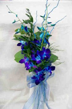 Flower to include (mostly b/c of vivid color): the blue/purple orchid's like they have at St Pete Saturday Morning Market .purple dendrobium orchids (fed a blue dye) Blue Orchid Bouquet, Blue And Purple Orchids, Blue Orchid Wedding, Blue Orchid Flower, Blue Dendrobium Orchids, Purple Flowers, Floral Wedding, Wedding Bouquets, Blue Lilies