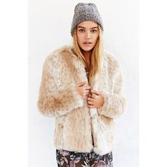 """L   UO Fur Coat Cozy faux-fur coat, from UO's own Kimchi Blue label, crafted from super soft spotted polyester and elastic cutouts at the sides. Compete with a button closure + side pockets.  Content + Care - Polyester  - Dry clean  - Imported  Size + Fit - Model is 5'9"""" and wearing size Medium - Measurements taken from size Medium - Chest: 47"""" - Length: 32"""" Urban Outfitters Jackets & Coats"""