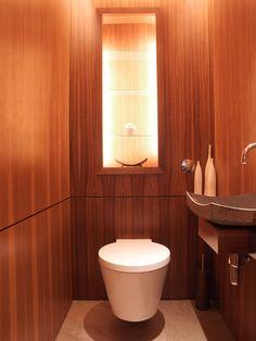 Illuminated in-set niche above the toilet