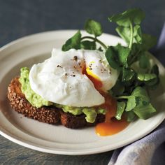 The nutty flavor of sesame toast and the peppery kick of cress add dimension to the combination of egg and avocado.