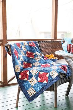 Designer Kimberly Purdy made this #quilt using fabrics specially designed to support the Quilts of Valor Foundation. This quilt features alternating pinwheel blocks and four-patch blocks. Digital pattern and quilt kit available! Find Sweet Land of Liberty in Easy Quilts Fall '14. #patriotic #QuiltofValor