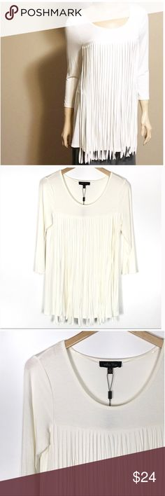 Ivory Fringed 3/4 Sleeve Tunic Top Ivory Fringed 3/4 Sleeve Tunic Top. Join the fringe trend with this ivory scoop Neck Blouse. 27 inches long. New with tags. Chest measures 18 inches across from armpit to armpit. 95% viscose 5% spandex.   🔺Questions? Please ask.  🔺I want your Poshmark experience to be easy & enjoyable. 🔺Thank you for shopping at Posh Mishmosh. #48💋 Tops