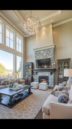 Dark Wood Coffee Table Real Stone Tv Over Fireplace Two Story Great Room High Ceilings M Loving That Chandelier Light Fixture