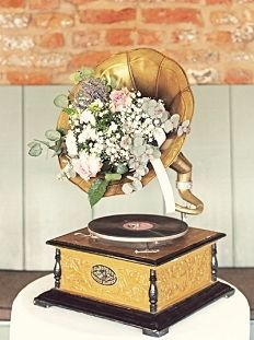 Love the phonograph, but add red or purple flowers for pop