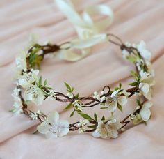 This classic woodland crown is made of small cream/beige wildflowers and wispy green foliage, with seed buds and vines. The stamens are hand-gilded to a subtle gold color – one of my signature touches! The crown has two layers, sitting comfortably on the head like a bonnet, and tying up
