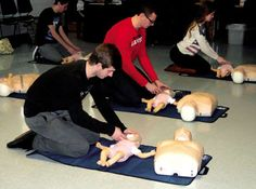 Claire Lowe / Ocean City High School seniors practice CPR on an infant during their physical education class Monday, March 9.