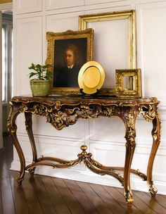 beautiful interior with French style carved console table; luxury interiors decorating ideas