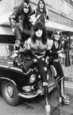 Kiss10th May 1976: American glam rock band KISS arrive at London Airport in all their finery, the boys are here to start their first ever European tour and have brought an arsenal of fireball machines, giant blow torches, rocket launching guitars, exploding drumsticks, etc, with them. They are, from left to right; Gene Simmons, Ace Frehley (back), Paul Stanley and Peter Criss (front). (Photo by Peter Cade/Central Press/Getty Images)